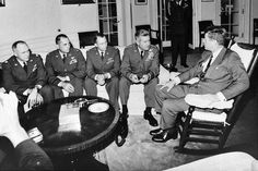 President Kennedy meets in the Oval Office with General Curtis LeMay and reconnaissance pilots who flew the Cuban missions. Third from the left is Major Richard Heyser who took the photos on which the Cuban missiles were first -Capturing History as it Really Happened in October 1962