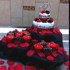 Black Red And White 2 Tier Wedding Cake With Matching Cupcakes