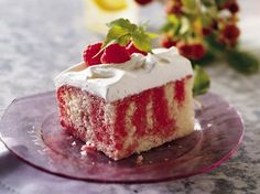 Raspberry Poke Cake by bettycrocker: Some cooks recommend adding one box(dry) instant vanilla pudding to the cake mix to prevent it from being soggy. #Cake #Raspberry #Jello