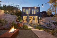 Street Contemporary Urban Oasis in San Francisco A home update adding a yard creating a beautiful urban oasis. (View Photos)A home update adding a yard creating a beautiful urban oasis. Outdoor Spaces, Indoor Outdoor, Outdoor Living, Outdoor Fire, San Francisco Houses, Design Jardin, Street House, Belle Villa, Wood Patio