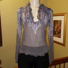 """ELI TAHARI TOP 100% silk See through  Chest laying flat from pit to pit measures 16"""" Elie Tahari Tops Blouses"""