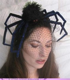 Buy any large spider in the Halloween Section of your Store... Glue or Pin some Black Netting under the Spider and place on your Head for a Lovely Headpiece for Halloween.