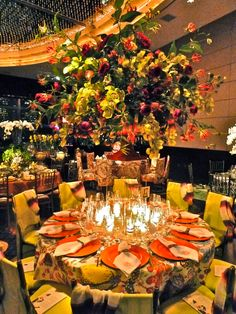 Fab over the top table via Quintessence. Love the orange and chartuese combo.