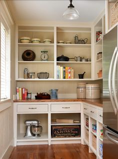 Located at the back of the house, this pantry was designed for function and to retain a well-fitted feel