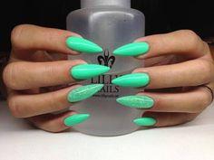 Teal stiletto nails