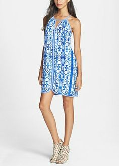 Add a pair of red sandals to this gorgeous blue and white print A-line dress, and you have the perfect outfit for the 4th of July.