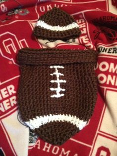 Baby Football Cocoon   Similar pattern can be found here:  http://hereinthewaitingplace.blogspot.co.il/search/label/Free%20crochet%20patterns
