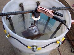 Rust Removal using Electrolysis - The five gallon bucket method is great for removing rust from small stuff; all you need to do is increase the container size for larger items.