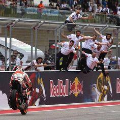Marquez' team celebrate as he reaches the end COTA '14