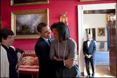 President Barack Obama hugs First Lady Michelle Obama in the Red Room