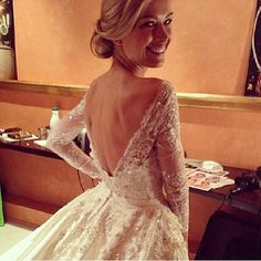 Never thought Id like a long sleeve wedding dress, but this is gorgeous. Love the plunging back!