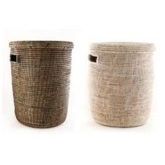 """Senegalese Lidded Laundry Hampers $99.00  Use them as Toy Bins, Bath Bins,Laundry bins, storage side-table with a tray on top...the possibilities are endless. These handmade baskets are extremely versatile. They have a convenient lid to hide away the mess as well as cut out handles for portability.  Available in two colors:  Natural, Black- Brown   Dimensions:  Approx: 14""""D X 19"""" T Origin: Senegal, West Africa"""