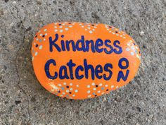 Kindness Catches On. Hand painted rock by Caroline.