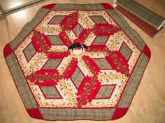 Christmas tree skirt constructed of 100% cotton fabric with low-loft polyester batting...  112 Christmas Presents by QuiltinWaYnE, $100.00