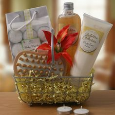Vanilla Dreams  Pamper Gift Basket    Our handy bath caddy carries the alluring sweet scent of vanilla. Inside she'll find vanilla cream bubble bath/body gel, body lotion, aromatherapy tealight candles and a wooden hand held body massager.