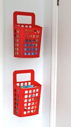 waste baskets as hanging storage. Great idea!