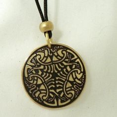 Irish handcrafted etched brass Celtic pendant.  Celtic birds as interlacing ornaments decorate this circular piece of Celtic jewellery by Aqua Fortress.  The crane is believed to be the messenger of the gods and to have a high degree of wisdom.  The crane represents higher states of consciousness.  A Celtic symbol interpreted as a wisdom symbol, a messenger of the gods symbol and also a higher state of consciousness symbol.  A handcrafted Irish gift, made in Beara, West Cork, Ireland.
