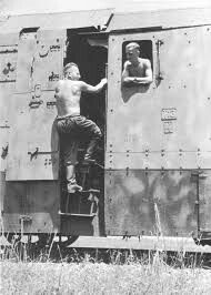 Excellent detail photo of a BR43 armored locomotive and the heavy armor thickness applied to the cab and boiler areas. The shirtless crew members relay a sense of just how hot operating inside that cab area was with that armor plated door was closed.