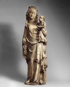 Virgin and Child.  Date:     ca. 1350 Geography:     Made in, Champagne, France Culture:     French Medium:     Marble with gilding Dimensions:     Overall: 34 5/8 x 10 3/4 x 5 7/8 in., 78lb. (87.9 x 27.3 x 14.9 cm, 35380.6g) Classification:     Sculpture