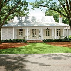 First of all I'm dying to paint or whitewash my brick house. I think the look of a white house is so crisp and clean. This house designed by Mia James in Baton Rouge is right up there as a to… House Plans One Story, Story House, Style Cottage, Farmhouse Style, French Cottage, Farmhouse Front, Coastal Farmhouse, Farmhouse Shutters, Farmhouse Garden