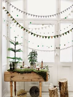 Winter garland. If you're lucky enough to have bright windows, you could do this.  if not, that's what blank walls are for.