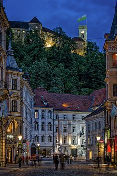 Photograph by Stuart Litoff.  #night in #Ljubljana #Slovenia with #Ljubljana #Castle, and the #Robba #Fountain in front of #town #hall.