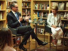 Daniel Silva talking with Barbara Peters.