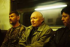 TUZAN DEDA VOZ - Moscow 2015 - Photography by Boogie: The subject matter of this image intrigued me. The soft yellow lighting compliments the sleepy expressions depicted on the faces of each of the people in the image. The old man positioned in the centre of the frame creates a strong focal point. Old Men, Moscow, Compliments, Che Guevara, Russia, Old Things, Centre, People, Faces