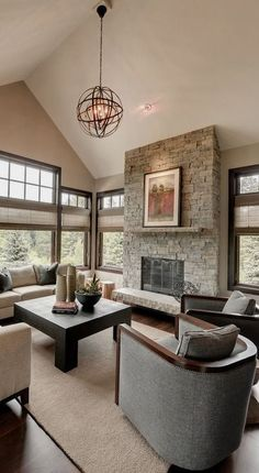 #homedesign #livingroomdecor #inspiration | Photo of a transitional family room in Minneapolis with beige walls, dark hardwood floors, a standard fireplace and a stone fireplace surround. — Houzz