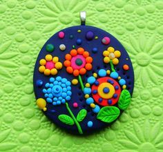 Fimo Polymer Clay Necklace Medallion - flowers in the night garden via Etsy