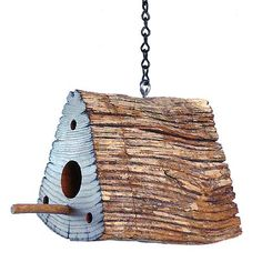 """Handmade Chestnut Fence Rail Birdhouse   This birdhouse is hand crafted from triangular segments of antique chestnut railing, hollowed out and provided with a 1.25"""" opening. Each has three screws in the face, allowing it to be removed for easy cleaning after birds leave the habitat."""