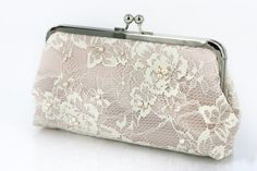 Ivory Lace Champagne Clutch beaded with Freshwater Pearls and Pearl Strap 8-inch. $120.00, via Etsy.