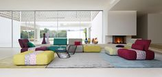 Modular sofa per elements upholstered in ATTRACTION fabric, central part in MISSONI HOME, CHRISTIAN LACROIX and AMLAPURA fabrics. Backs with double depth and ...