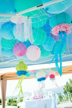 Mermaid Princess Party- hanging jelly fish !! Sooooo cute. This would be adorable as the Little Mermaid version of their party.