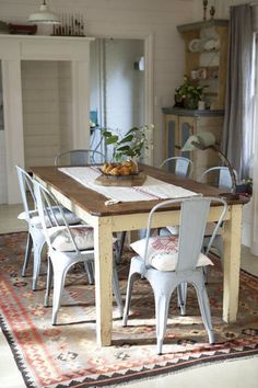 dining room with tolix chairs & vintage wooden table