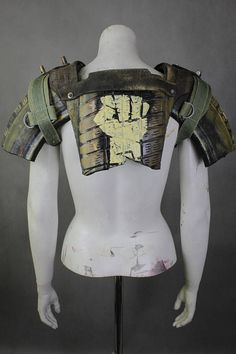 Post Apocalyptic Breastplate - Spaulder for Post Apocalyptic Warrior - Mad Max Armor - Tire Spaulder Wasteland Raider - LARP Gladiator Prop  Designer of the project is Viola Sychowska, founder of Wasted Couture collective. The spaulder inspiration came from wasteland raiders from Fallout game series. It is really post apocalyptic and has a lot of recycled elements like tires with some tribe creative – outstanding machine screw and dark and yelow colours.  Spaulder is made from car tires…