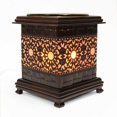 """Arabella Ave by Tina  http://www.arabellaave.com/#a_aid=TinaGowans  METAL ASIAN SUN STYLE OIL WARMERS  $26.00 Everyone who purchases this or any of our warmers will get their choice of a free essential oil or free package of candle melts!   These are 6"""" tall. Dish is removable for easy clean up. Uses one 35 watt halogen bulb (included). Power cord measures 5' in length and has dimmer switch allows you to control the intensity of the light to warm the oil to your desired fragrance level."""