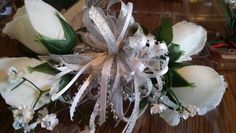 White rose wrist corsage with silver accent