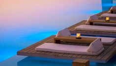 Love the cushions right on the ground!    Mykonos Pool Bars | Cavo Tagoo Lounge Bar | Pool Bar Mykonos Island Greece