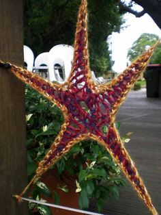 Like the idea of making a ton of stars. Easy to hang by the points. yarn bomb crochet graffiti