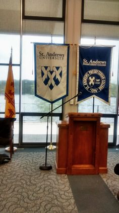 We go into the auditorium and get seated for the Spring 2015, April 9th convocation ceremonies. St. Andrews University. North Carolina. The back drop is the campus lake.
