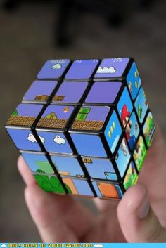 Whoever said video games rot the mind clearly never tried their hand at the Super Mario Bros Rubik's Cube. Each side of this Nintendo themed Rubik's Cube . Deco Gamer, Retro Game, Nintendo, Mario Bros., Mario Toys, Mario Party, Cube Puzzle, Mario Brothers, Geek Out