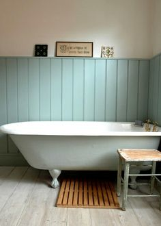love a simple bathroom with panelling - for colour and display. and a stool - for companionship, or wine glass