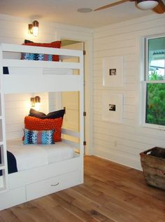 Design Chic - such a clean and classic room  - perfect for a beach house.  Love the white paneled walls and the bunk beds are perfection with the ship's lights for reading!