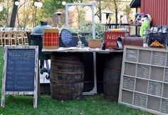 North Country Vintage welcome table made from old barrels and door.