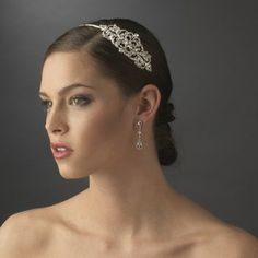 HP 8339 Silver  This elegant silver plated bridal hair band, has a beautiful rhinestone vintage accent of swirls, slightly centered off to the side, for a unique and exquisite touch. The beautiful glistening rhinestone components will capture the light during your indoor or outdoor wedding ceremony, and deliver a beautiful radiating sparkle that family, friends, and guests will fall in love with. #timelesstreasure