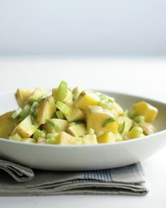 Potato Salad with Celery and Scallions - Thinly sliced celery and scallions add crunch to this Yukon Gold potato salad. A classic vinaigrette of Dijon mustard, white-wine vinegar, and olive oil make it a picnic-friendly salad.