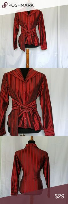 "PULI RED BLACK STRIPE SATIN SHIRT JACKET 8 PULI RED BLACK STRIPE SATIN SHIRT JACKET . This elegant shirt/jacket has an attached belt with large ma5ching buckle. Has long sleeves with 1 button cuffs.  Satiny looking but is 100% easy care polyester. Beautiful rich cranberry red. Armpit to armpit is 19.5""*and shoulder to hem length is 24"". All measurements are approximate and taken flat. Puli Tops Blouses"
