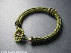 The herringbone tube is 8 beads wide, with 5 dark olive, and 3 yellow lined at the 'back'. I find it helps give the rope a more bangle-like shape. Bracelet Making, Jewelry Making, Beaded Jewelry Designs, Bead Jewelry, Beads Pictures, Beaded Necklace, Beaded Bracelets, Beads And Wire, Bead Crochet