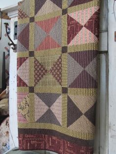 BIG hourglass block. Love the striped sashing